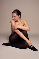 Beautiful topless woman in black pantyhose