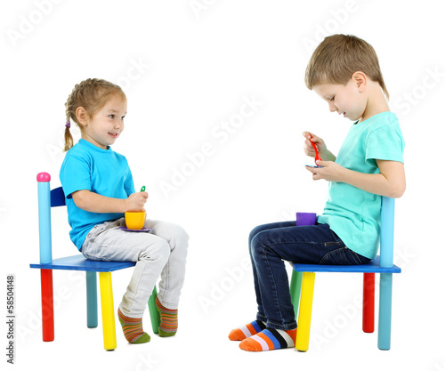 Little children playing with colorful tableware isolated