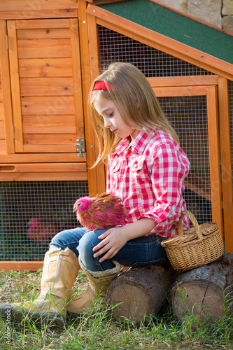 breeder hens kid girl rancher farmer with chicks in chicken coop