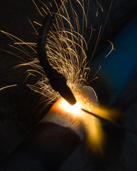 Sparks of the fused metal