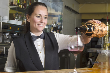 waitress serving red wine