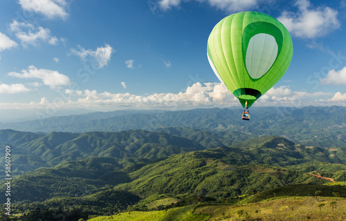 Hot air balloon over the mountain