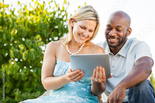 Couple looking at tablet PC