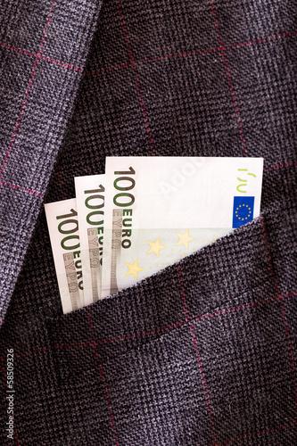 Euro banknotes in pocket closeup