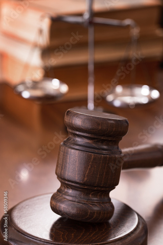 Gavel with scales and books