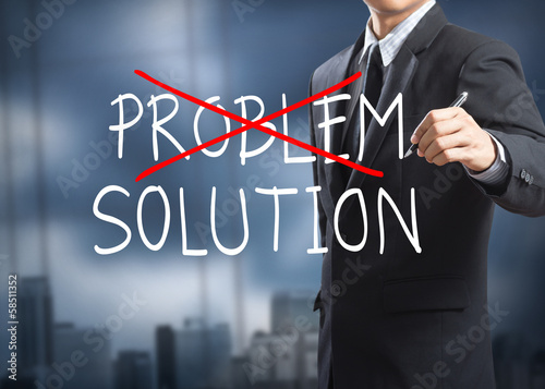 Businessman drawing crossing out problem and finding solution