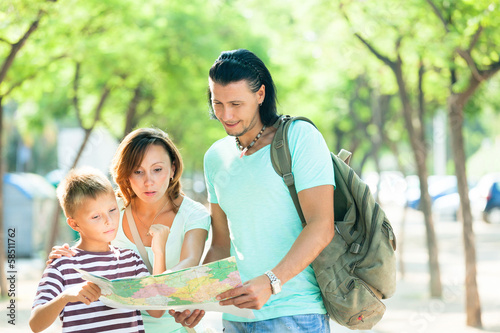couple with teenage child traveling together