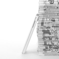 Phone and Newspapers folded and stacked concept