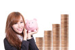 Business woman happy holding piggy bank