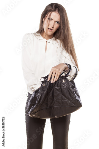 nervous business woman looking for something in her hand bag