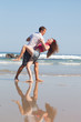loving couple dances on the sea coast
