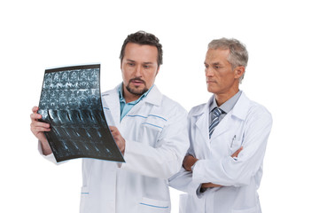 Two experienced doctors discussing X-ray.