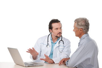 Adult doctor talking to old patient.