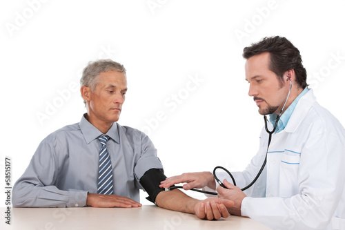 Adult doctor checking pressure of old patient.