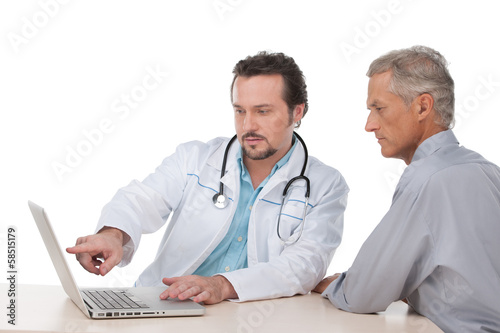 Doctor  showing on laptop test results to his patient.