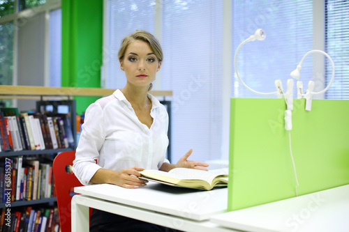 girl engaged in the reading room of the library