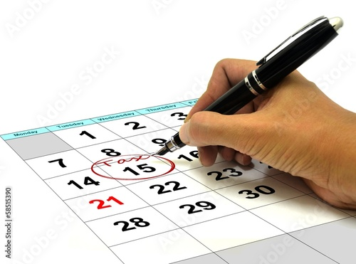 Hand Circling Tax Date on a Calender with Pen