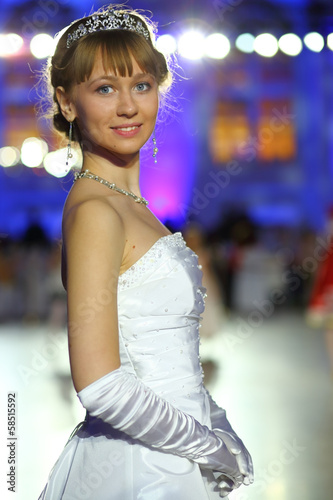 Portrait of beautiful young girl in a white ball gown
