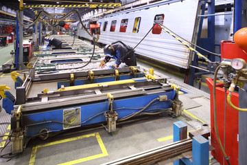 The process of welding body of the wagon by worker