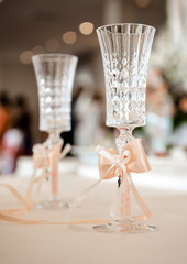 Champagne glasses decorated with orange bows