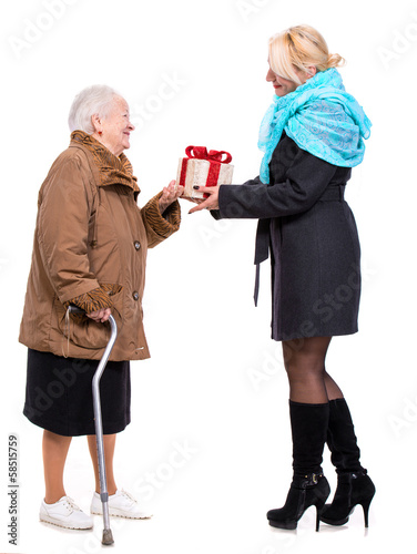 Grandaughter giving gift to her grandmother