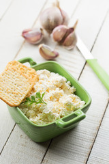 Cottage cheese with garlic and herbs.