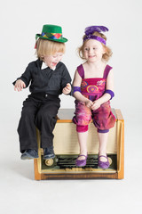 Smiling little boy and girl sitting on radiogramophone