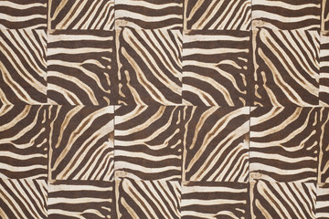 Striped animal pattern composed of square pieces