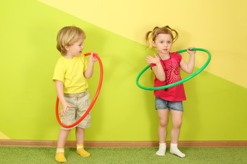 Little boy and girl with green and red hoops