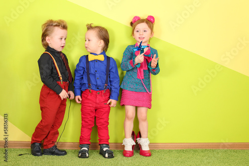 Two boys and one girl in a bright clothing