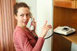 Young woman talking on a rotary phone