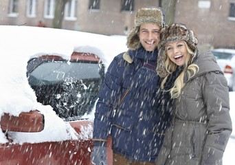 Happy couple in snowfall