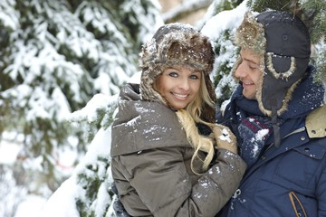 Loving couple embracing in winter forest