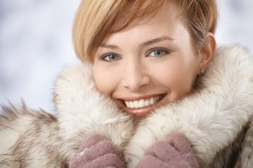 Attractive young woman in fur coat