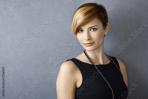 Beautiful young woman wearing pearl necklace