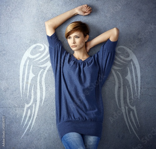 Attractive woman with angel wings