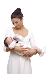 Beautiful young mother holding baby boy