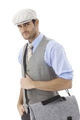 Portrait of young man in hat and shoulder bag