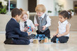 Children in business dress playing with toys