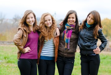 Four happy teenage friends