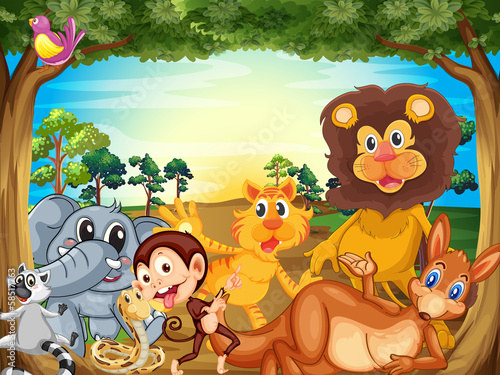 A group of animals relaxing under the tree