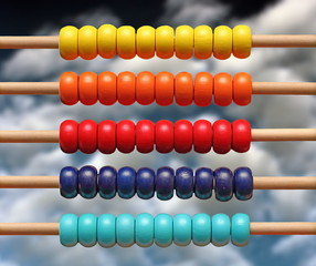 colorful wood abacus over sky