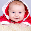 newborn baby in a Santa drass