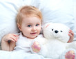 baby lying in a white bed