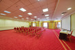 Empty conference hall with a red carpet on the floor