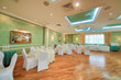 hall with elegant tables in restaurant decorated for wedding