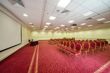 Elegant empty conference hall with a red carpet