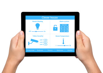 isolated men hands hold a tablet with system clever house on the