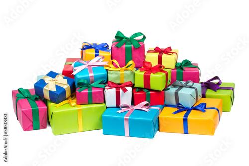 Leinwanddruck Bild Bunte Geschenke vor weißem Hintergrund