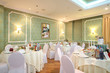 hall with tables in restaurant decorated for wedding